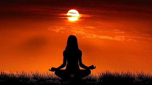meditation Gyan Yoga by girl in sun rise